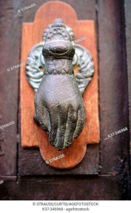 Antique door knocker with hand. San Miguel de Allende. Mexico