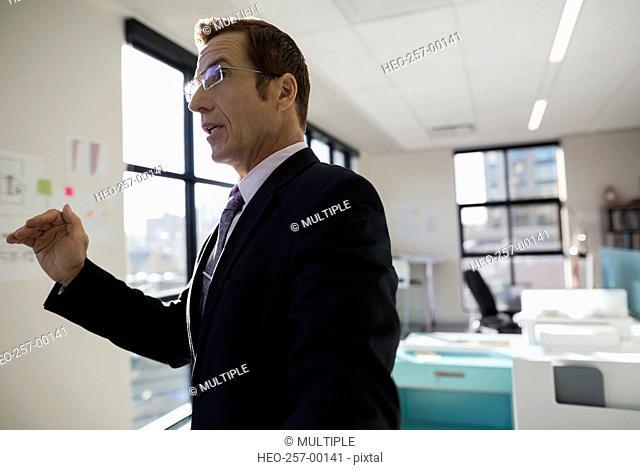 Businessman gesturing in office