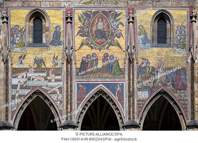 10 April 2018, Czech Republic, Prague: A view of the souther entrance of St. Vitus Cathedral on Prague Castle. The mosaic above the church portal depicts scenes...