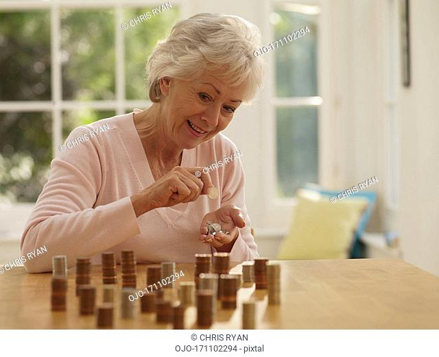 Woman putting coins into stacks