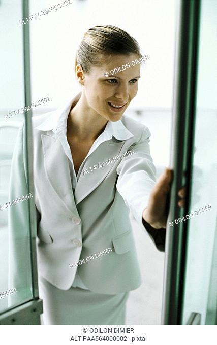 Businesswoman entering building
