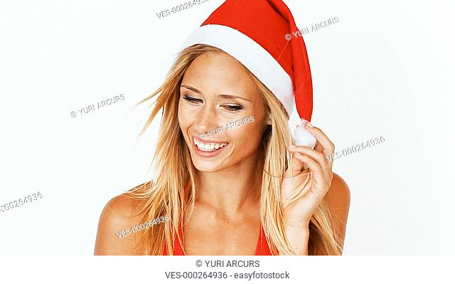A happy young woman excited about her presents isolated on white