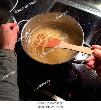 spaghetti cooking in a pot