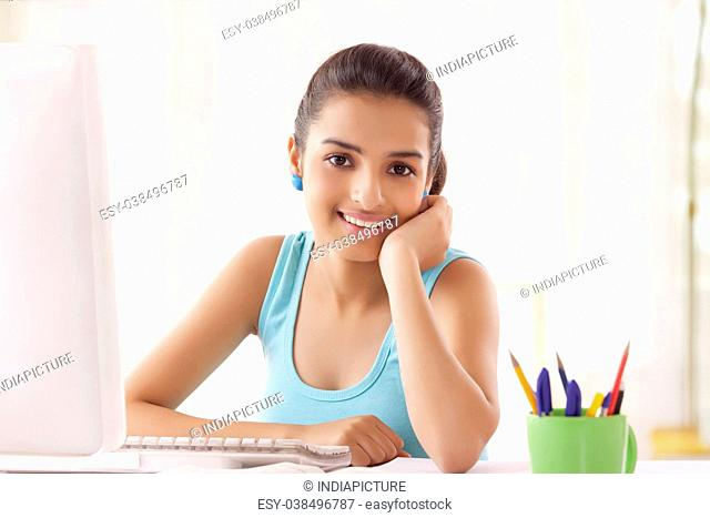Teenage Girls using computer at home