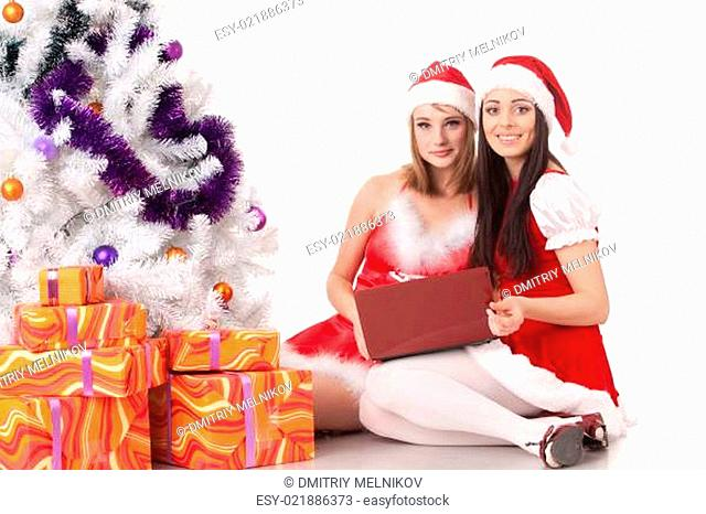 Christmas girlfriends with laptop