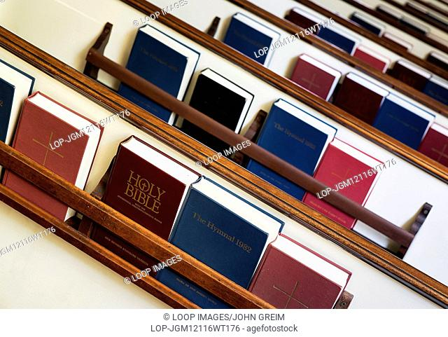 Prayer books and hymnals in church pew