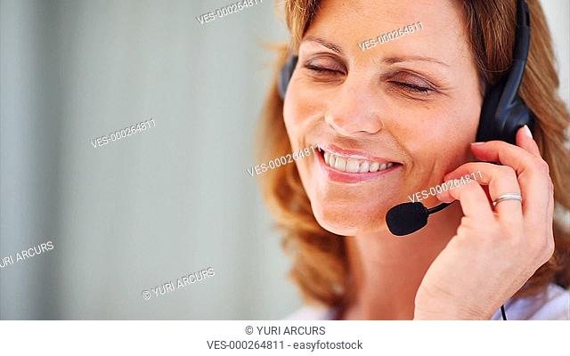 Pretty call center representative gives you a smile while she is at work