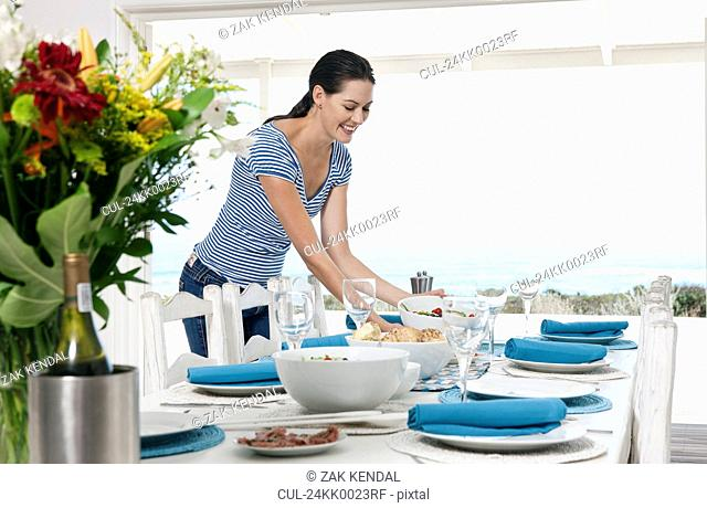 Preparing a table for a meal