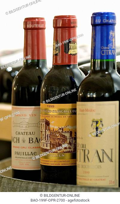 This stock photo of Expensive French Wine Bottles in a wine cellar
