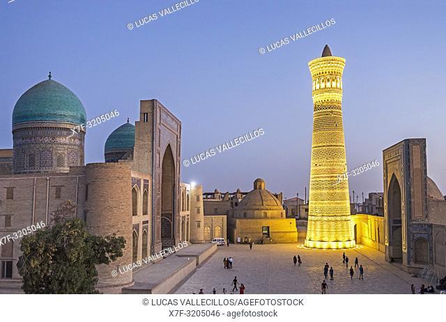 At right Kalon minaret and mosque. At left Mir-i-Arab medressa , Bukhara, Uzbekistan