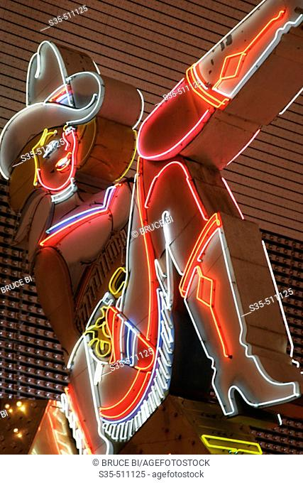 A neon cowgirls sign on Fremont Street, Old Town, Las Vegas, Nevada, USA