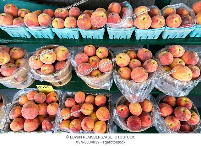 High angle view of baskets of juicy peaches sitting on shelves awaiting to be bought, Shawsville, Maryland