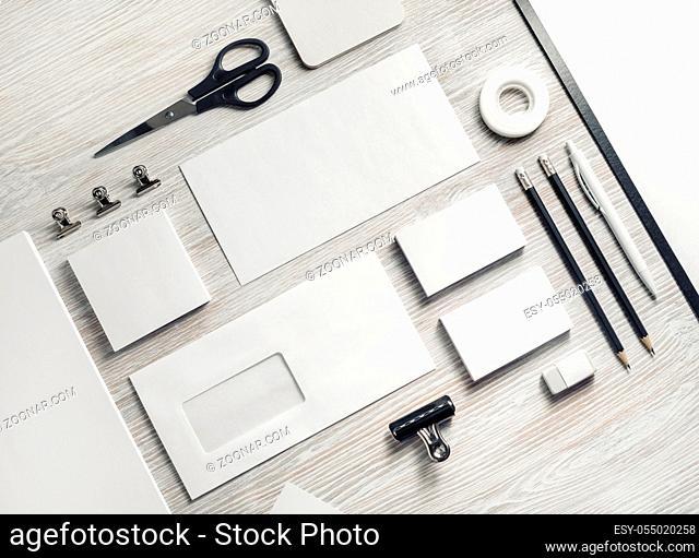 Blank corporate stationery set on light wood table background. Template for branding design. Branding mock up