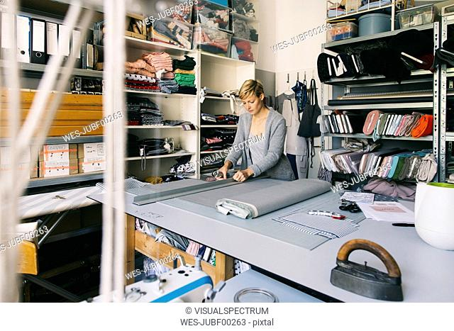 Fashion designer working on template in studio