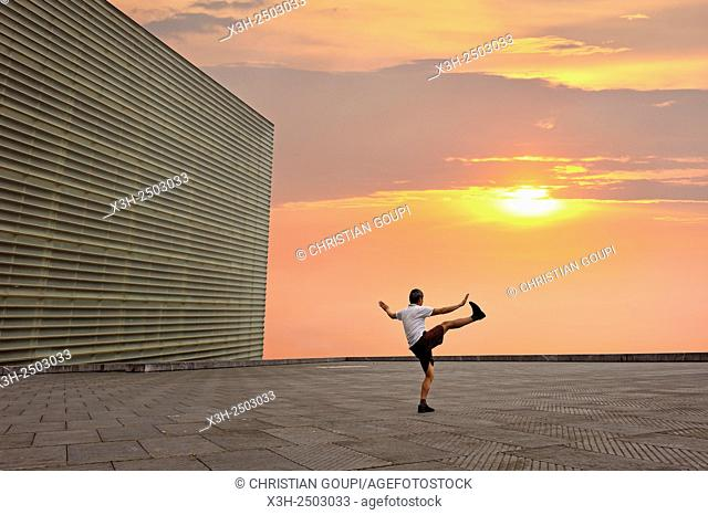 man practising Tai-Chi on esplanade of Kursaal Congress Centre and Auditorium by Spanish architect Rafael Moneo, San Sebastian, Bay of Biscay
