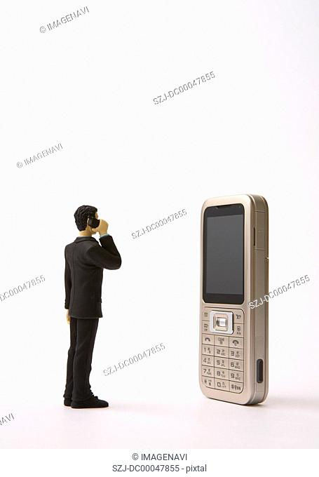 Mobile phone and miniature businessman