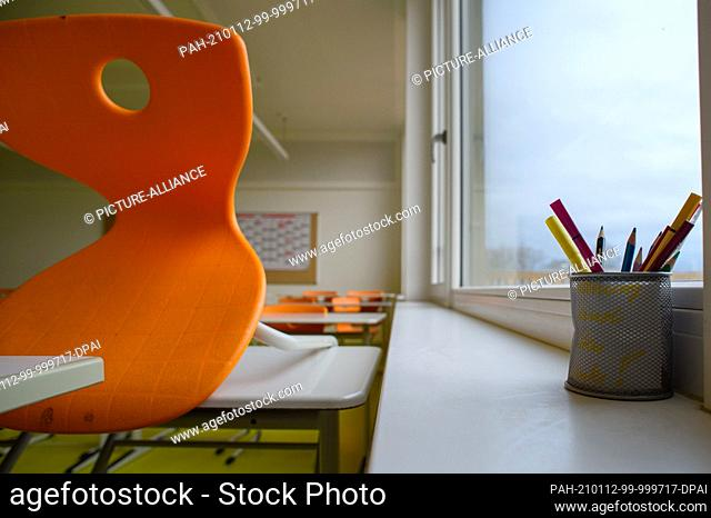 12 January 2021, Saxony-Anhalt, Gardelegen: Pencils stand in a cup on the windowsill in an unused classroom at Karl Marx Secondary School