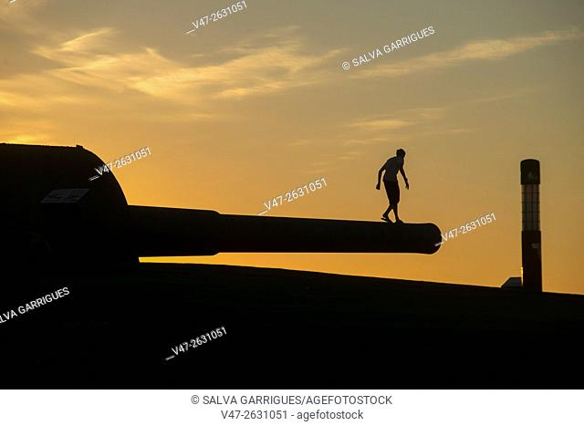Children walking above the cannon of Mount San Pedro, La Coruna, Galicia, Spain, Europe