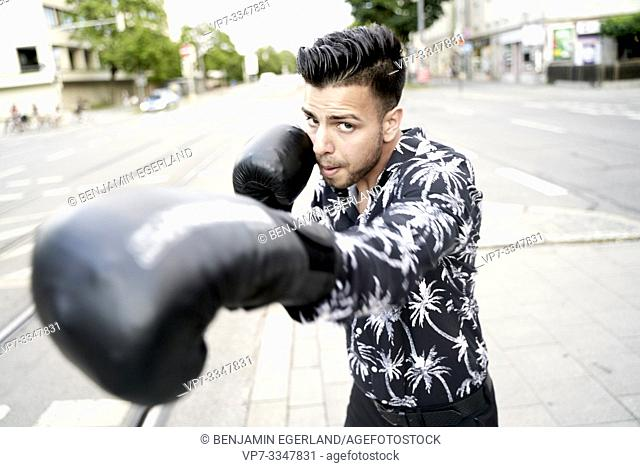 young competitive Afghan man fighting at street, boxer