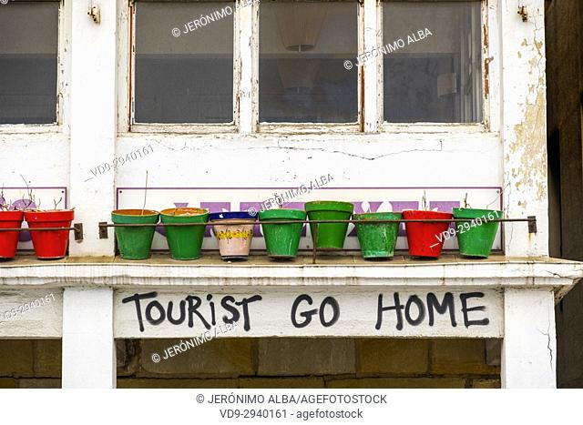 Tourist go home graffiti. Pasaia San Pedro. Fishing village. San Sebastian, Bay of Biscay, province of Gipuzkoa, Basque Country, Spain, Europe