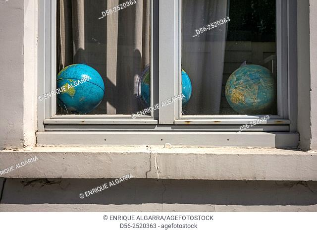 globes in a window, Bruges, Belgium