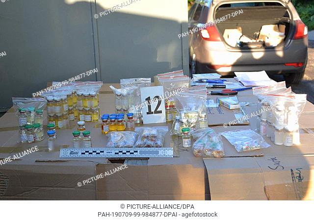dpatop - HANDOUT - 09 July 2019, ---, -: The undated photograph, issued by Europol, shows confiscated doping substances at an unknown location on a table