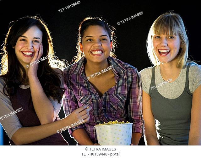 Young girls eating popcorn