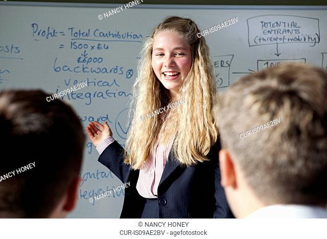 Schoolgirl presenting ideas in classroom