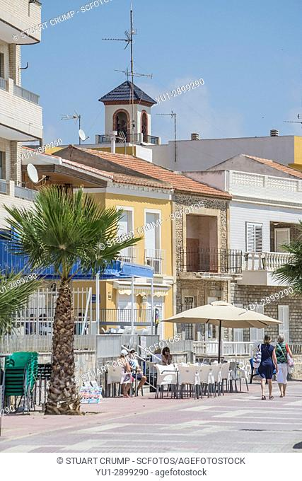 Promenade with palm tree and cafe bar at Los Alcazares in Murcia, Spain