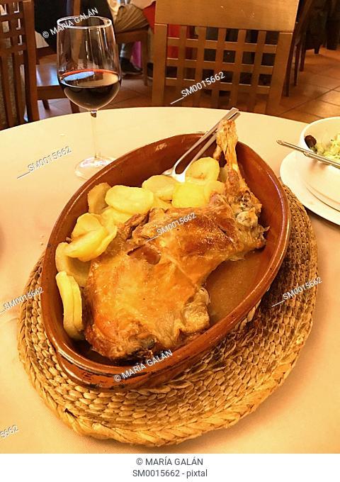 Roast lamb serving. Spain