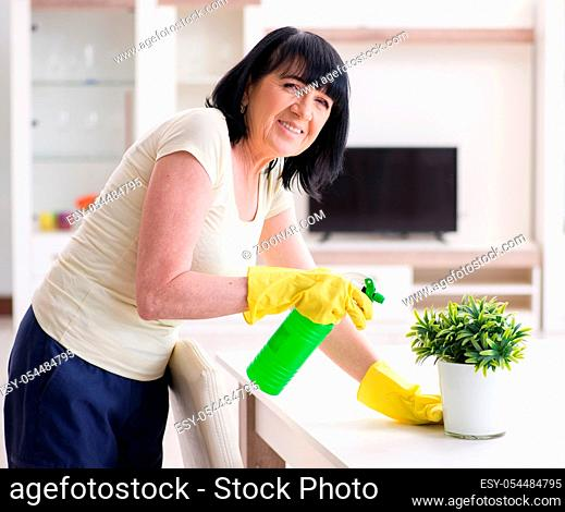 The old mature woman tired after house chores