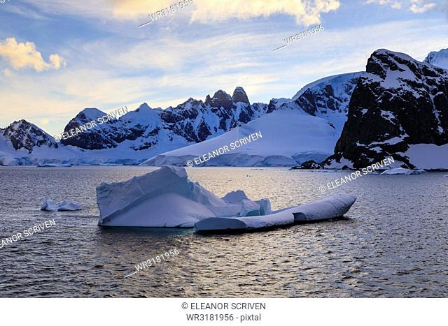 Sunrise, atmospheric clouds, mountains, glaciers and icebergs, Danco Coast, Gerlache Strait, Antarctic Peninsula, Antarctica, Polar Regions