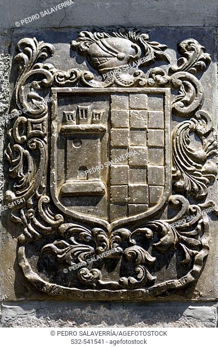 Coat of arms on the façade. Acumuer, Valle de Tena. Huesca province. Aragon. Spain
