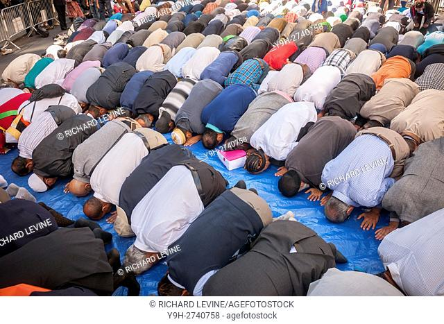 Muslims from the tri-state pray on Madison Avenue in New York prior to the American Muslim Parade. The annual parade, now in it's 31st year