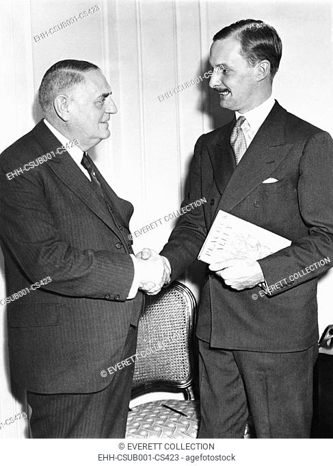 Waldorf Astor (right), grandson of William Waldorf Astor in New York, Oct 23, 1933. He is welcomed to the Waldorf Astoria Hotel by Oscar Tschirky