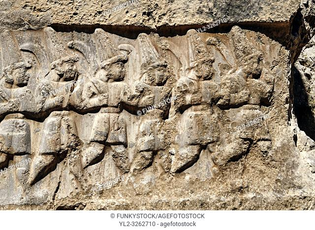 Close up of the sculpture of the twelve gods of the underworld from the 13th century BC Hittite religious rock carvings of Yazılıkaya Hittite rock sanctuary