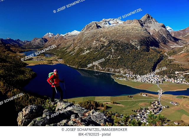 Woman, mountaineer with red jacket, behind Lake Silvaplana, Piz Lagrev, Albula Alps, Upper Engadine, Canton Graubünden, Switzerland