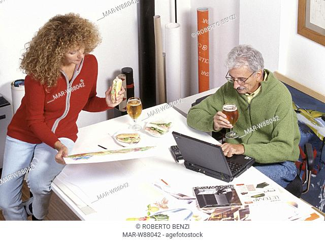 couple with computer, beer