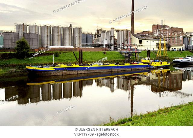 inland vessel, tanker vessels in Harbour, silos and tanks in background - NEUSS, GERMANY, 15/03/2007