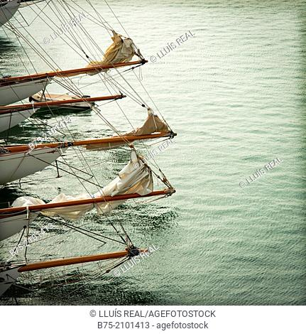 Several bowsprit of a classic sailboat moored at the Port Mahon, Menorca, Balearic Islands, Spain