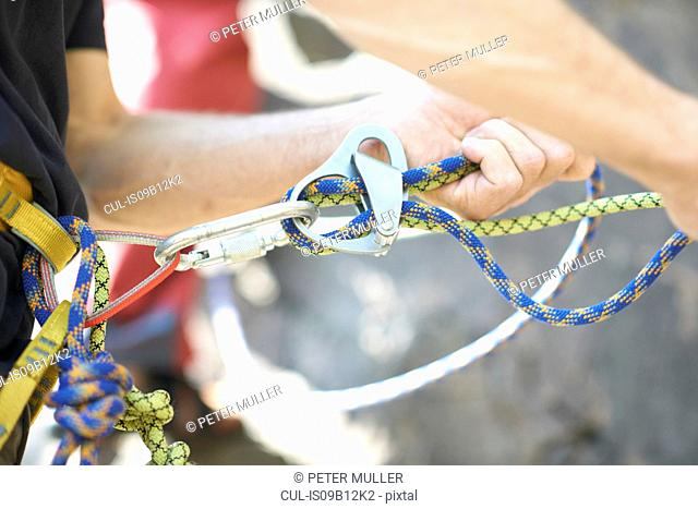Close up of ascender on climbing rope