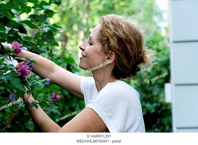 Profile of smiling woman gardening