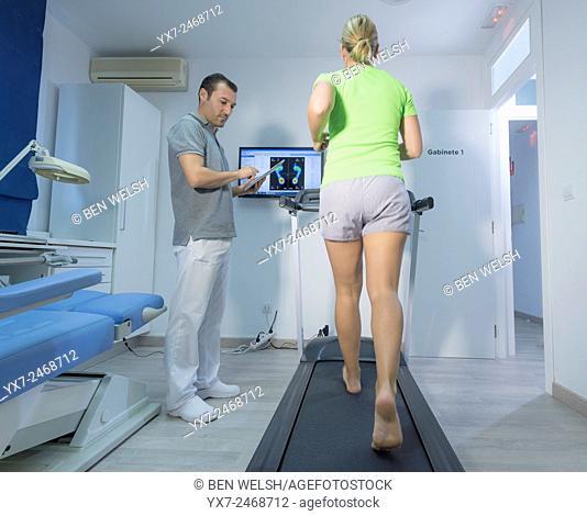 Podiatrist with a patient