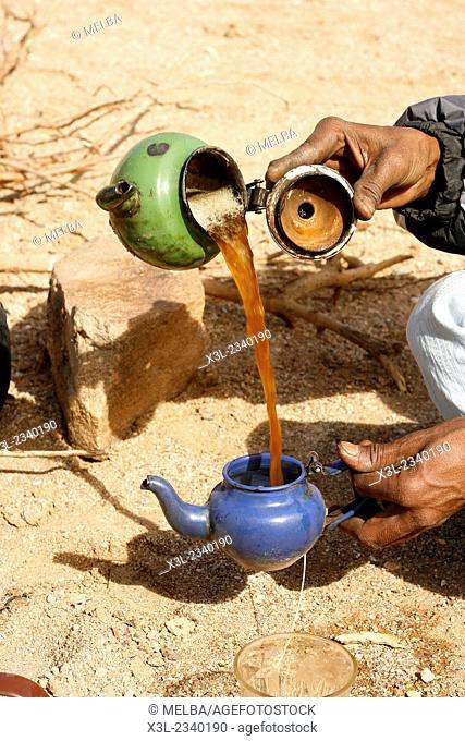 Tuareg making tea. Oued Tin Tarabine. Tassili Ahaggar at sunset. Algeria