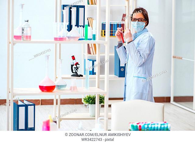 Female chemist working in hospital lab
