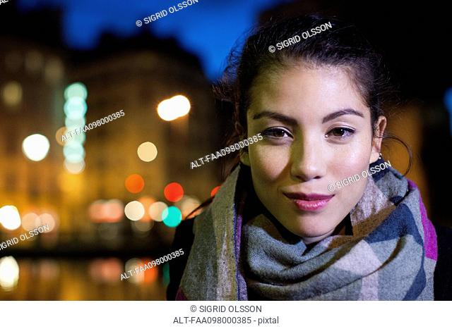 Young woman outdoors dressed warmly, portrait