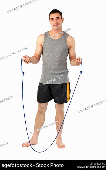 Young sportsman preparing for jump roping