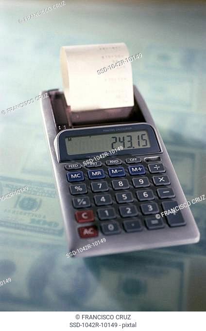 Calculator on American dollar bills