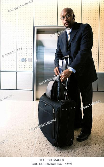 African businessman with suitcase