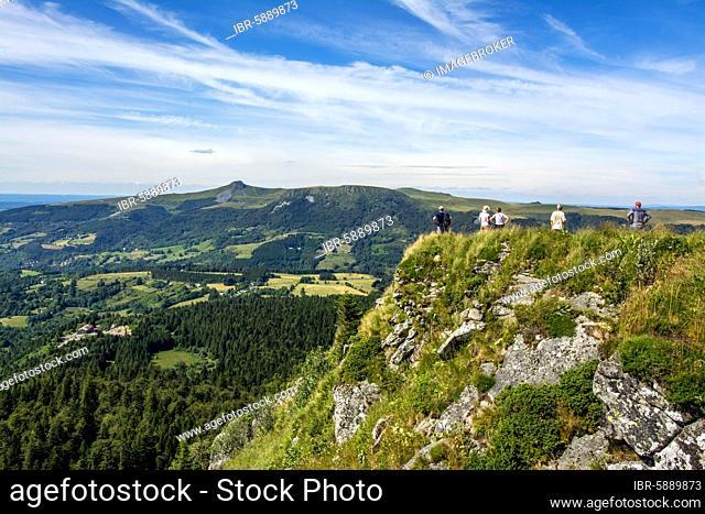 Walkers in the Sancy massif at back, Auvergne Volcanoes Natural Park, Puy de Dome department, Auvergne-Rhone-Alpes, France, Europe